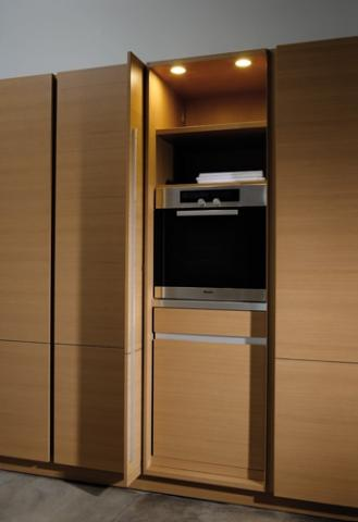 Hide-away Tall Cabinet Doors Conceal A Dishwasher and Oven ...